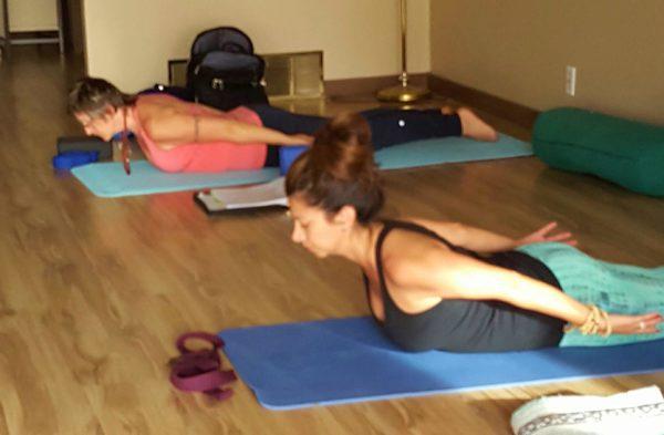 yoga-students-sarpasana-pose